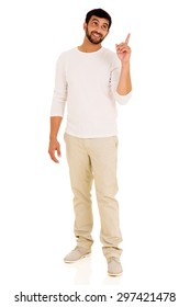 happy indian man pointing up on white background