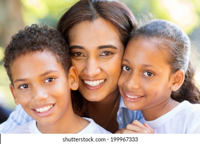 happy indian mother and her adorable kids closeup portrait