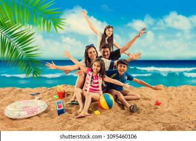 Happy Indian/Asian family playing at the beach. Summer vacation concept