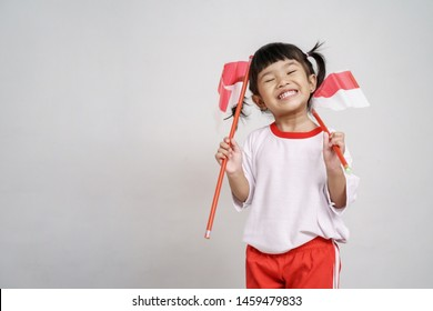 happy indonesian kid with flag over white background