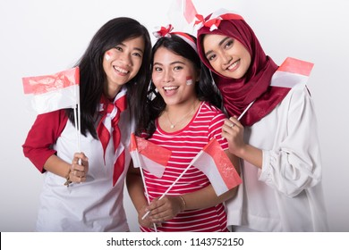 happy indonesian woman with flag celebrating independence day