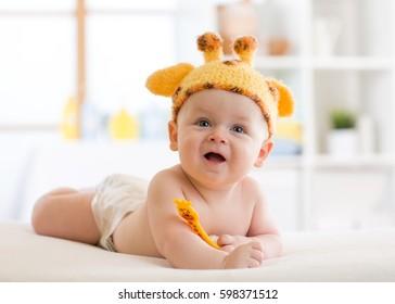 happy infant baby child in giraffe costume