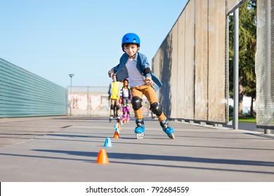 Happy inline skater slaloming at skate park