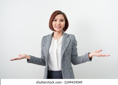 Happy inspired businesswoman dressed in office clothes looking at the camera surprisingly and smiling open arms on white background