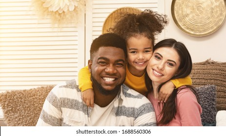 Happy international family hugging and staying at home during epidemic