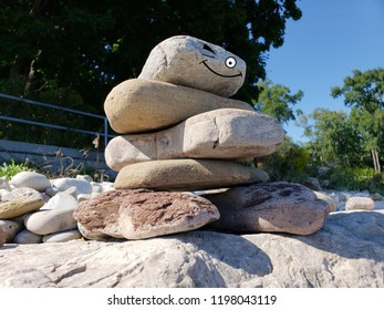 Happy inuksuk winking made of piled rocks