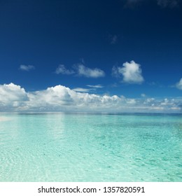 Happy island lifestyle. Сrystal-blue sea of tropical beach. Vacation at Paradise. Ocean beach relax, travel to Maldives islands
