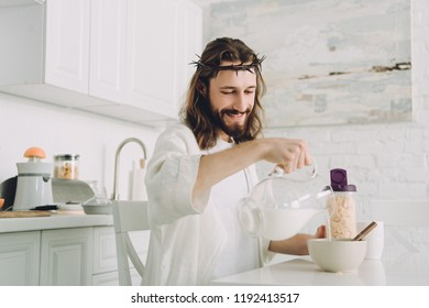 happy Jesus pouring milk into bowl with corn flakes on breakfast in kitchen at home