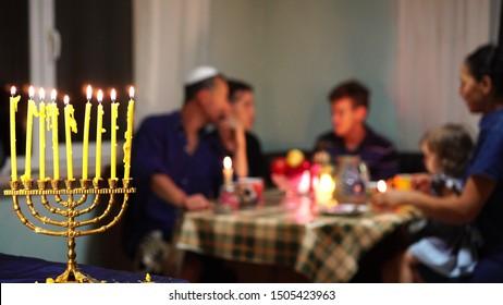 Happy Jewish Family Celebrates Hanukkah. Festival of Lights. Israel people. The Hanukkah menorah