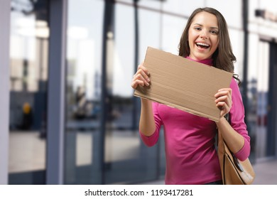 Happy Jobseeker with Hire Me Sign