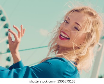 Happy joful adult fashionable woman smiling cheerfully wearing blue navy shirt and red lipstick.