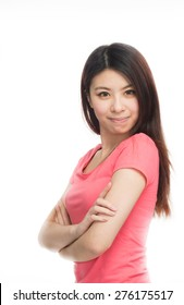 Happy joking asian girl looking weirdly at the camera.  Isolated on white.