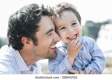 An happy joyful father having fun with is child
