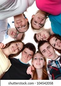 Happy joyful friends forming a circle of head