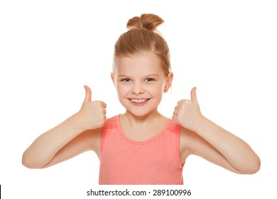 Happy joyful little girl smiling showing thumbs up, isolated on white background