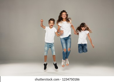 Happy jumping young friends