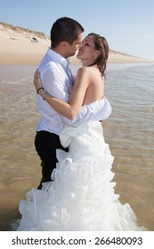 Happy just married couple on the beach