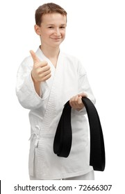Happy karate Kid with black belt in hand