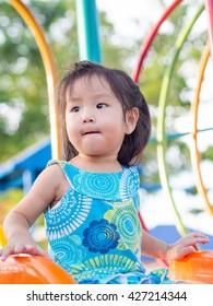 Happy kid, asian baby child playing on playground