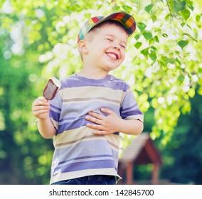 happy kid boy eating ice cream