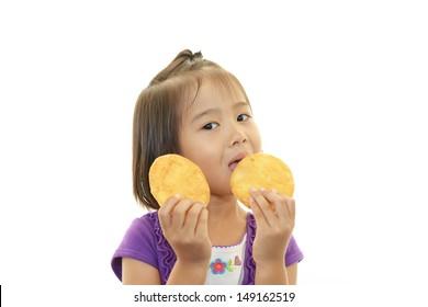 Happy kid eating snack