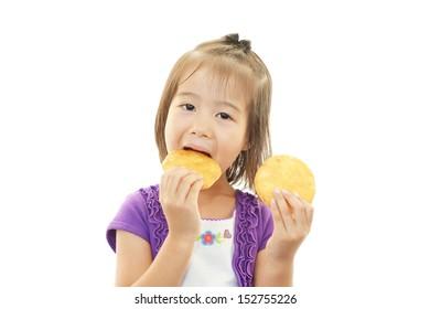 Happy kid eating snacks