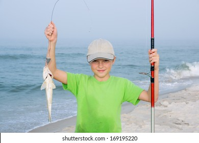 Happy kid with a fishing rod and fish  Gulf Kingfish.Background of the Gulf of Mexico. Focus on the child's face