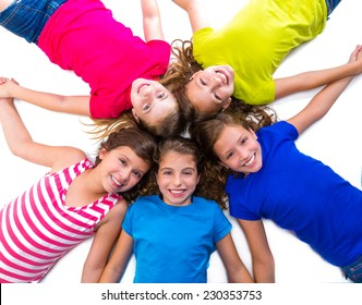 happy kid friend girls group smiling aerial view lying on circle over white background holding hands