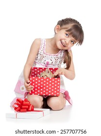 happy kid girl holding gift box with cat kitten