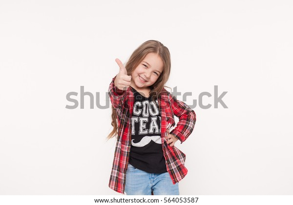 Happy kid girl with thumb up sign