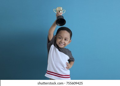 happy kid holding trophy