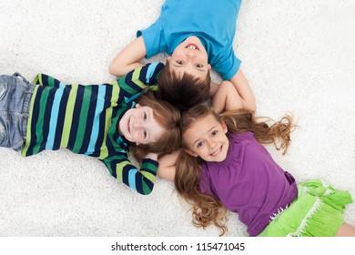 Happy kid laying on the floor - head to head