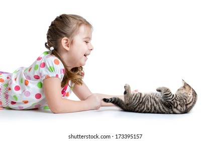 happy kid lying on floor and playing with cat kitten