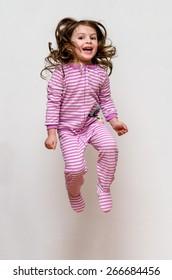 Happy kid pajama jumping