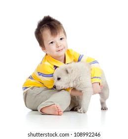 happy kid playing and hugging puppy dog