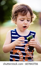 Happy kid playing outdoors. Cute child having fun in the garden