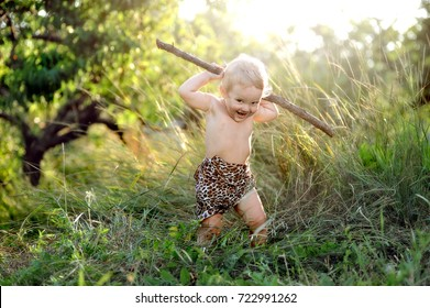 Happy kid playing with a stick on nature