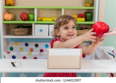 Happy kid playing in thw kindergarden