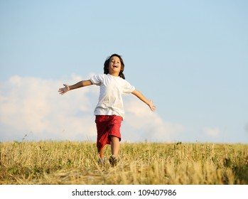 Happy kid running on beautiful field
