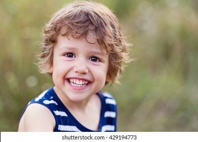 A happy kid smiling and laughing