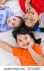 happy kids ,baby on the floor laying on