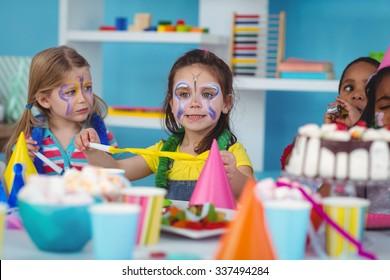 Happy kids celebrating a birthday together