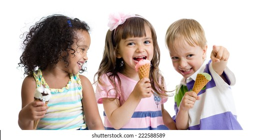 happy kids eating ice cream in studio isolated on white