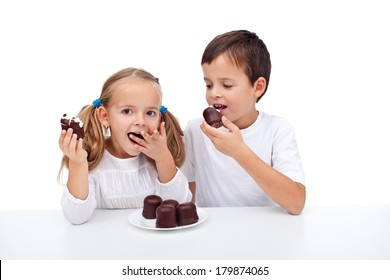 Happy kids eating whipped cream and chocolate dessert - isolated