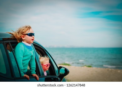 happy kids enjoy travel by car at sea