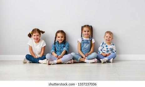 happy kids friends around the empty walls