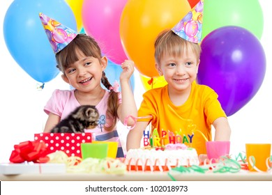 happy kids girl and boy celebrating birthday party