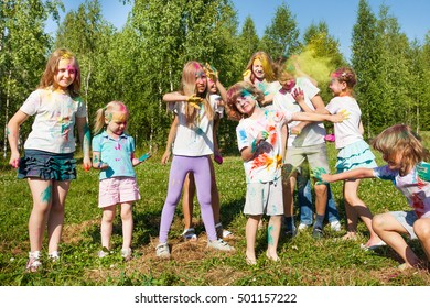 Happy kids having fun celebrating color festival