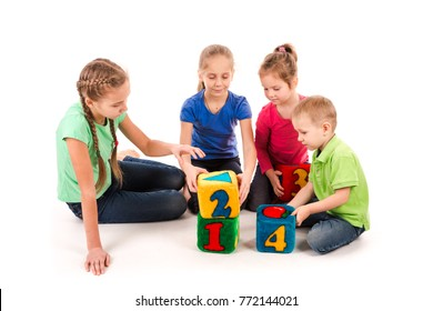 Happy kids holding blocks with numbers over white background. Teamwork concept.