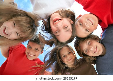 Happy Kids Huddling and Looking Down at the Viewer